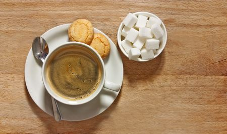 rustic shot of filter coffee and biscuits on table