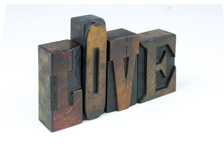 The word love in wooden letterpress printing block letters