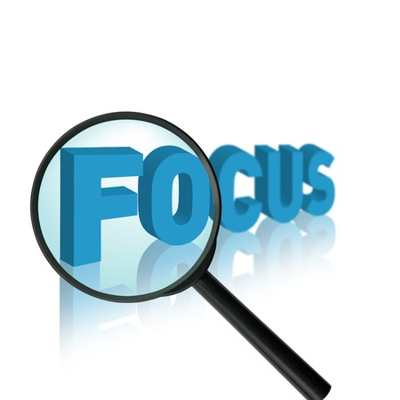 Photo for the word focus with a magnifying glass - Royalty Free Image
