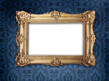 regency or victorian style gold frame hanging on decorative blue patterned wallpaper
