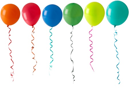 coloured party balloons and streamers floating on a white background
