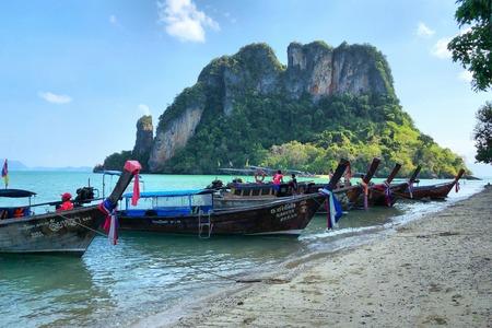 KRABI THAILAND  3 FEB 2018: Long tail boats anchored at the Island in Krabi Province Thailand. Phi Phi is part of Mu Ko Phi Phi National Park.