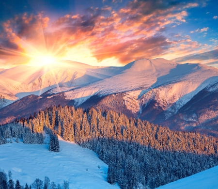 Colorful winter sunrise in mountains.