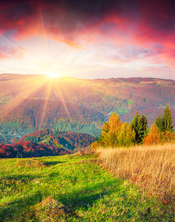 Colorful autumn sunrise in the Carpathian mountains. Sokilsky ridge, Ukraine, Europe.
