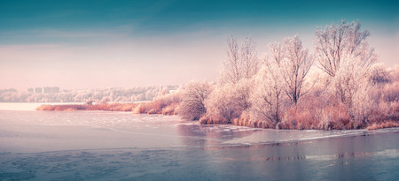 Panorama of the frozen pond in the city park. Instagram toning.