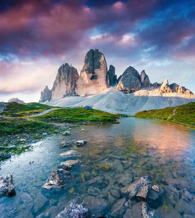 Colorful summer scene on the lake Rienza - Ursprung in National Park Tre Cime di Lavaredo. Sunrisi in Dolomite, South Tyrol. Location Auronzo, Italy, Europe.