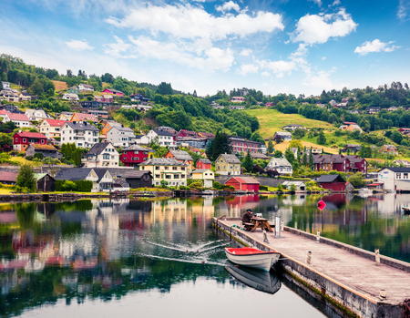 Rainy summer view of Norheimsund village, located on the northern side of the Hardangerfjord. Colorful morning scene in Norway, Europe. Traveling concept background.