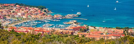 Foto de Panoramic spring cityscape of Palau port, Province of Olbia-Tempio, Italy, Europe. Aerial morning scene of Sardinia island. Sunny mediterranean seascape. Traveling concept background. - Imagen libre de derechos
