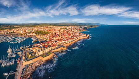 Photo pour View from flying drone. Wonderful summer cityscape of Alghero port, Province of Sassari, Italy, Europe. Incredible evening scene of Sardinia island, Mediterranean seascape. Traveling concept background. - image libre de droit