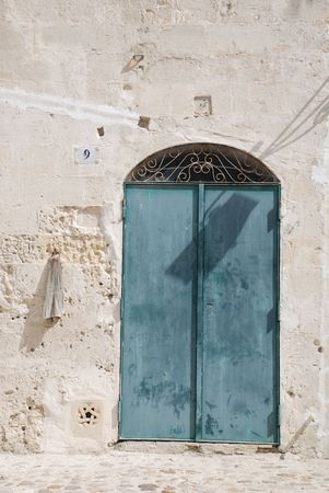 A door in the Caveoso Sassi in the Italian town of Matera in the region of Basilicata. The town is famous these stone houses which are a UNESCO World Heritage Site