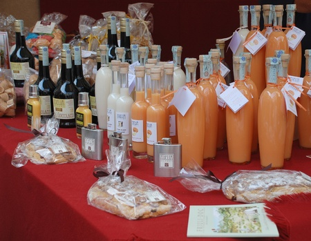 Udine, Italy -  September 17th 2011 -  A selection of locally produced alcoholic drinks on display at a street stall during  the 2011 annual Friuli Doc (Udine) celebration of locally produced food, drinks and crafts (Friuli Doc)