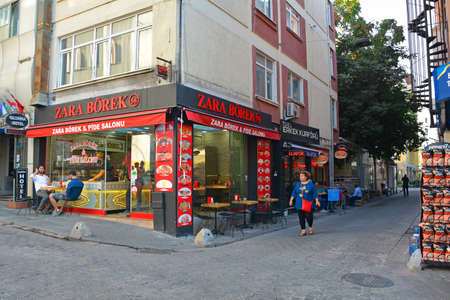 Foto per Istanbul, Turkey - September 18th 2019. Customers enjoy a meal outside a borek and pide fast food restaurant in the Moda district of Kadikoy on the Asian side of Istanbul - Immagine Royalty Free