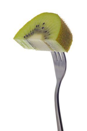 Slice of kiwi fruit held by fork isolated on white background