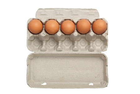 Egg carton half full or half empty of eggs isolated on white background