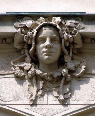Art Nouveau sculpture on the wall in Prague, Czech Republic