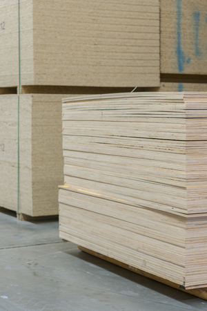 timber in warehouse. Pallet with boards in the hardware store. Packed boards in the building store. building materials. warehouse with variety of timber for construction and repair. vertical photo.