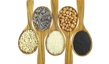 Cereals on wooden spoon