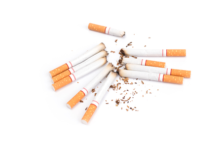 Photo pour Cigarettes with ash isolated on a white background - image libre de droit