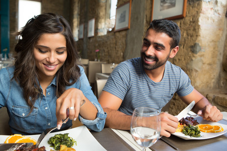 Photo pour Couple having lunch at rustic gourmet restaurant - image libre de droit