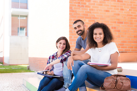 Photo pour Group of students sitting on school stairs - image libre de droit