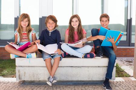 Photo pour Group of happy little school kids in school - image libre de droit