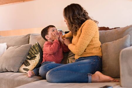 Photo for Mother and son relaxing together in the living room - Royalty Free Image