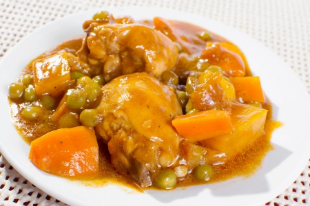 chicken stew with potatoes, carrots, green peas in tomato sauce