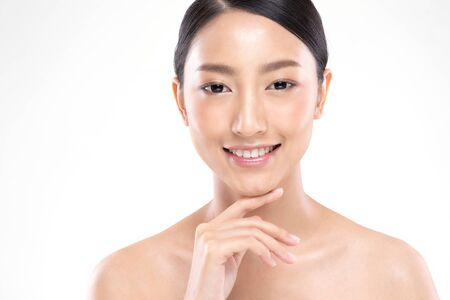 Photo pour Beautiful Young Asian Woman Looking While Touching Chin feeling so happy and cheerful with healthy Clean and Fresh skin,isolated on white background,Beauty Cosmetology Concept - image libre de droit
