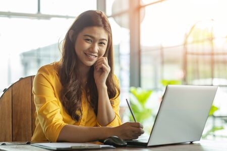 Photo for Beautiful Attractive Asian woman working with computer laptop and thinking to get ideas and requirement in Business startup feeling so happiness,Business Startup Concept - Royalty Free Image