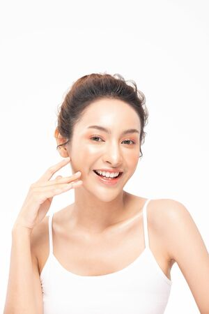 Foto de Beautiful Asian woman touching soft cheek smile with clean and fresh skin Happiness and cheerful with positive emotional,isolated on white background,Beauty and Cosmetics Concept - Imagen libre de derechos