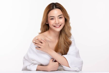 Photo pour Beautiful Asian woman wearing bathrobe smile with clean and fresh skin Happiness and cheerful with positive emotional,isolated on white background,Beauty Cosmetics and spa Treatment Concept - image libre de droit