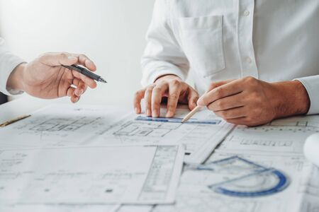 Photo pour Team Engineer drawing graphic planning and meeting for architectural project on workplace - image libre de droit