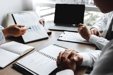 Foto de Business team meeting Strategy Planning with new startup project plan Finance and Economy Graph with laptop successful teamwork - Imagen libre de derechos