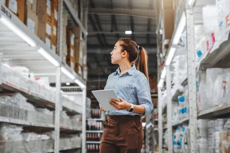 Photo for Asian woman worker working with digital tablet checking boxes Logistic import and export supplies packages in Warehouse , Logistics concept - Royalty Free Image