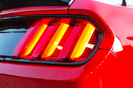 Dimensional lanterns of the red modern sport car. Photo.