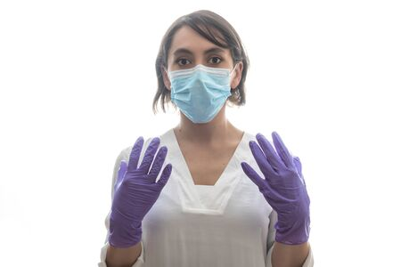 Woman with white shirt, purple gloves and mask ready for covid19. With white background. Horizontal photo.