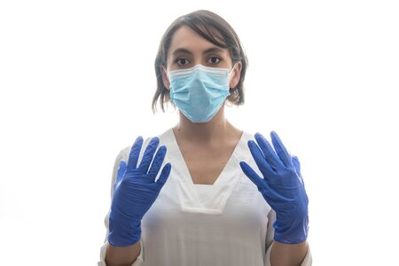 Woman with white shirt, blue gloves and mask ready for covid19. With white background. Horizontal photo.