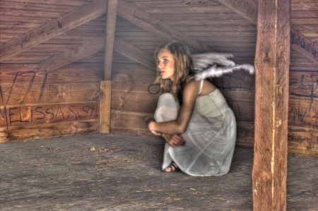A scared Angel hiding in a shelter