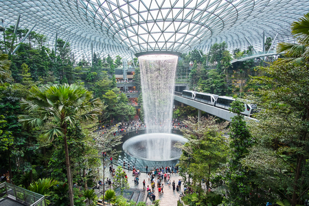 Photo pour The Giant water fall HSBC Rain Vortex and beautiful green nature Shiseido Forest Valley in the Jewel Changi Airport, link to terminal Changi international Airport in Singapore; Singapore, 11 May 2019 - image libre de droit
