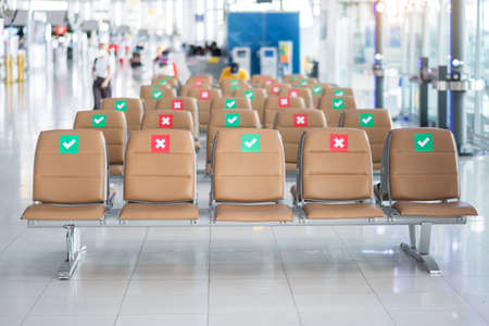 Photo pour Symbol sticker on chair in international airport. New Normal and social distancing concepts, protection Coronavirus disease (Covid-19) infection - image libre de droit