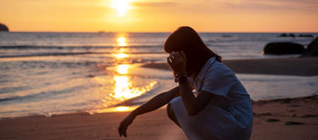 Photo for Silhouette of young woman against beautiful sunset at the beach. - Royalty Free Image