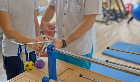 Photo for Hand therapy with physiotherapist Equipments - Royalty Free Image