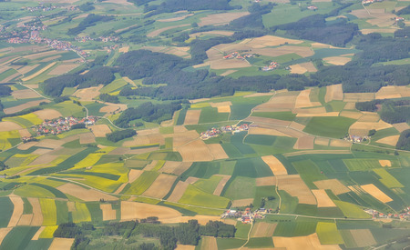 Aerial view over villages in spring time