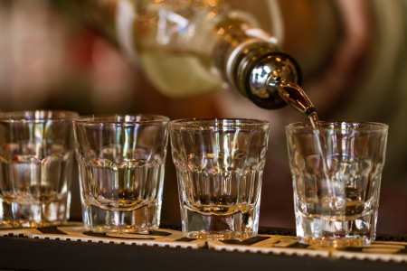 Barman make alcoholic shots in nightclub