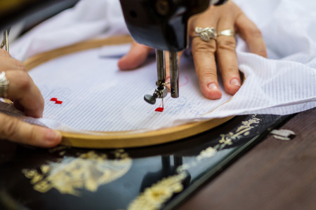 Photo pour Textile  embroidery machine. Machine embroidery is used to create patterns on textiles. - image libre de droit