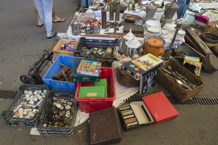 Barcelona, Spain - June 18, 2014  Objects used, artwork and ornaments on a market stall in the most famous flea market in Barcelona, also known as Els Encants or Els Encants Vells, located in Glories neighborhood Objects used, furniture, artwork and ornam