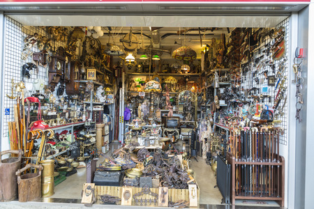 Barcelona, Spain - June 18, 2014  Objects used, furniture, artwork and ornaments on a market stall in the most famous flea market in Barcelona, also known as Els Encants or Els Encants Vells, located in Glories neighborhood Objects used, furniture, artwor