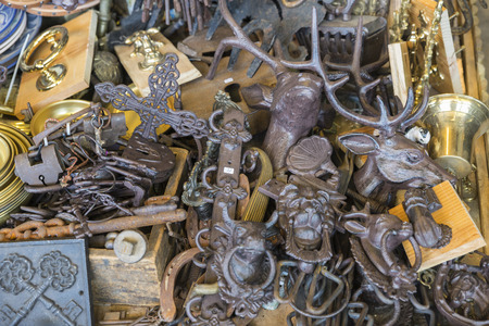 Barcelona, Spain - June 18, 2014  Objects used, keys and ornaments on a market stall in the most famous flea market in Barcelona, also known as Els Encants or Els Encants Vells, located in Glories neighborhood Objects used, furniture, artwork and ornament