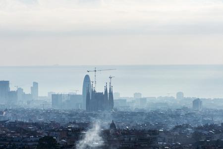 Panoramic views of Barcelona at sunrise, Catalonia, Spain. In the image highlights the Sagrada Familia