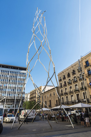 Barcelona, Spain - September 20, 2017: Homenatge als Castellers, it is a conceptual sculpture formed by a stainless steel structure, with people around in the Ghotic quarter of Barcelona, Catalonia, Spain